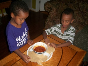 Brothers eating injera.
