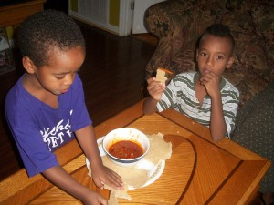Little Brothers eating injera.